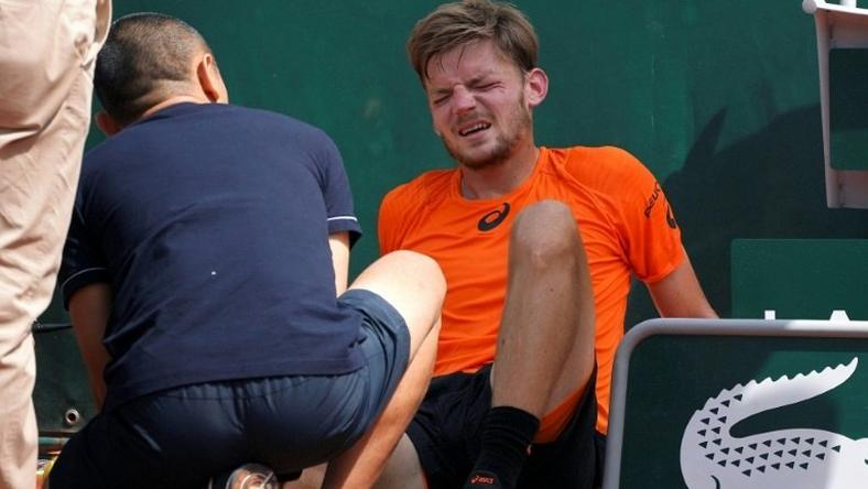 Belgium's David Goffin quit his third round match at the French Open after suffering a freak ankle injury when he got caught up in the court covers