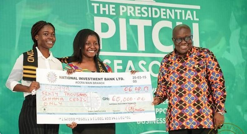 Matilda Asantewaa Sampong and Emilee Otoo Quayson receive cheque from President Akufo-Addo