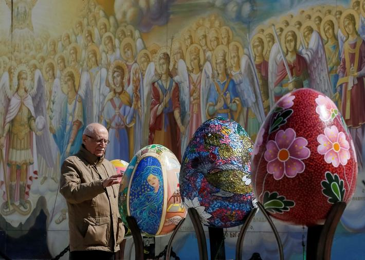 "Man looks at traditional Ukrainian Easter egg ""Pysanka"", displayed at square, as part of upcoming Ea"