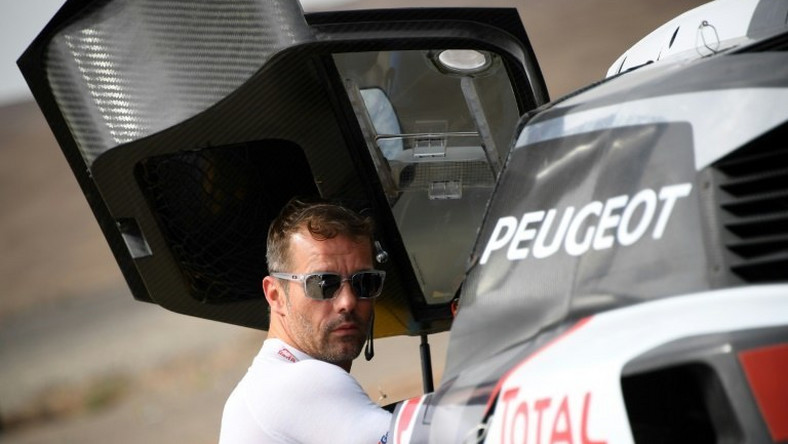 Peugeot's French driver Sebastien Loeb gets ready for a start of the Silk Way 2017 between Urumqi and Hami China, on July 17, 2017