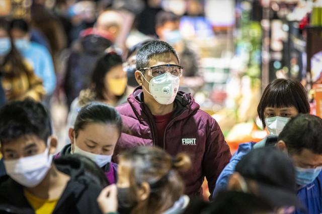 Građani kineskog Guangžua sa maskama na licu zbog korona virusa