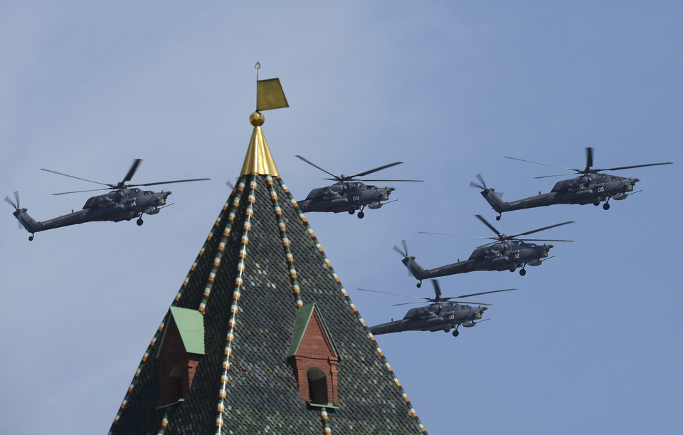 Russian Mil Mi-28N Havoc helicopters fly in formation over the Red Square during the Victory Day parade in Moscow