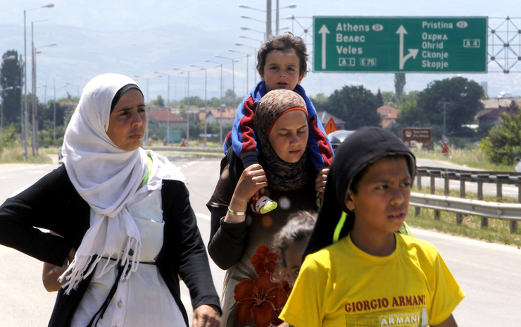626495_women-and-children-migrants-from-syria-walk-along-an-express-road-east-of-skopje-macedonia-ap