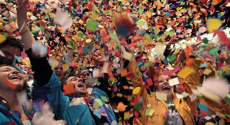 Traders and clerks at the CME Group toss confetti. Scott Olson/Getty Images