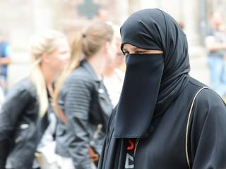 An Islamic woman going shopping in Vienna