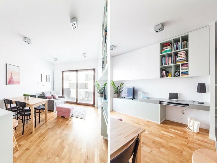 Zabudowane, białe i lekkie meble w salonie stanowią miejsce do składowania rzeczy.