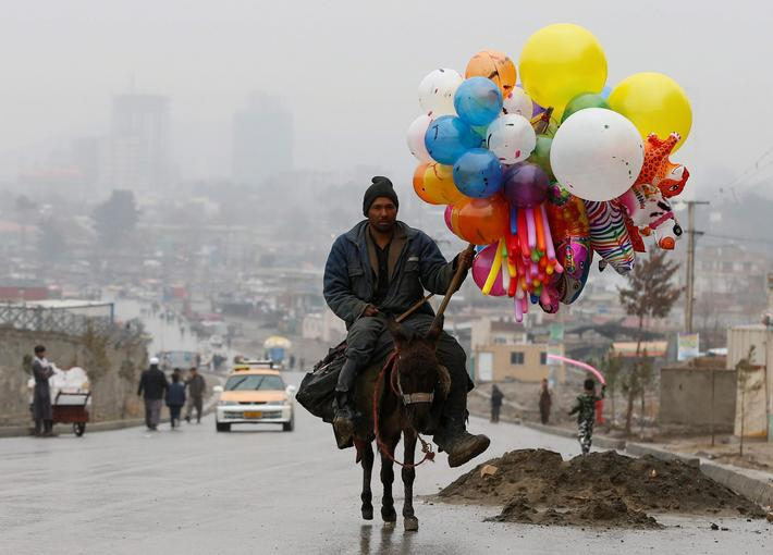 An Afghan man rides on his donkey during Newroz Day celebrations in Kabul