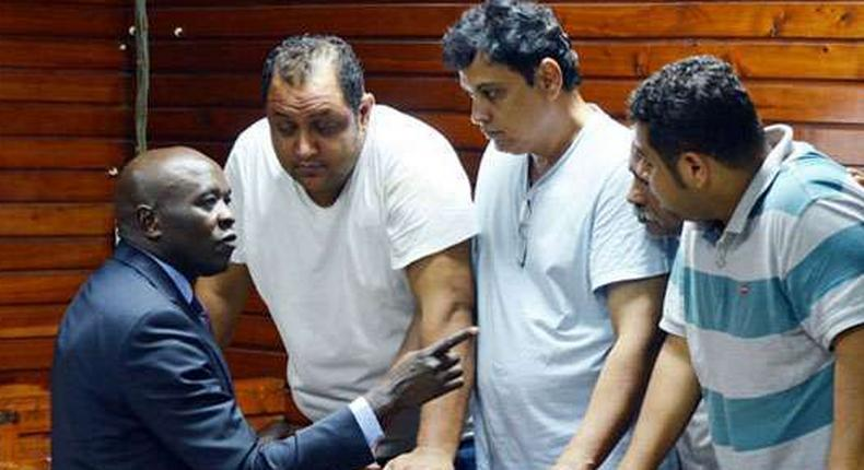 From left, lawyer Cliff Ombeta with suspects Baktash Akasha, Vijay Goswami, Gulam Hussein and Ibrahim Akasha at the Mombasa Law Courts