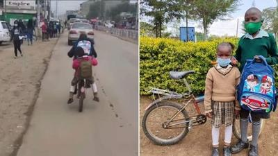 Kenyans reward viral boy who carries sister to school daily on a bicycle 4km away