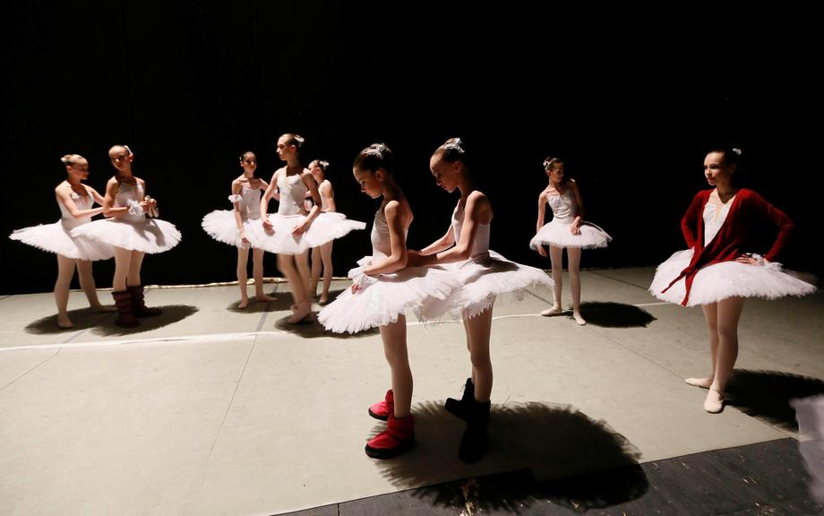 Students of Krasnoyarsk choreographic college prepare backstage before performance by graduates at S