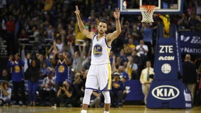 Record-breaker Curry shines as Warriors down Pelicans
