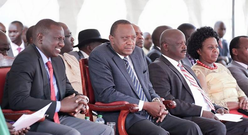 A file photo of President Uhuru Kenyatta  (centre) with his deputy William Ruto (left),  and former Bomet Governors Isaac Ruto (2nd from right), and the late Joyce laboso