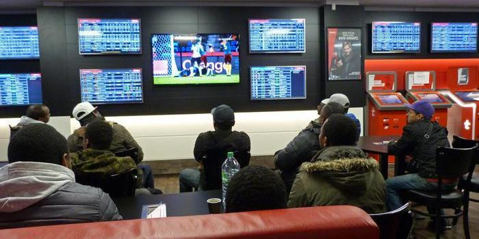 Gamblers in a betting shop in Kenya