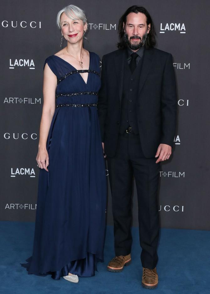 Kijanu Rivs sa devojkom Aleksandrom