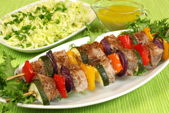 9305_stock-photo-shish-kebab-delicious-meat-cuisine-with-zucchini-onions-and-peppers-salad-in-background--shutterstock_55179898