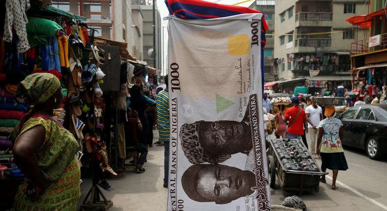 A towel with a print of the Nigerian naira is displayed for sale at a street market in the central business district in Nigeria's commercial capital Lagos February 4, 2016. REUTERS/Akintunde Akinleye/File Photo