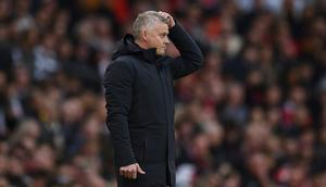 Manchester United manager Ole Gunnar Solskjaer is clinging to his job after a 5-0 thrashing at home to Liverpool Creator: Oli SCARFF