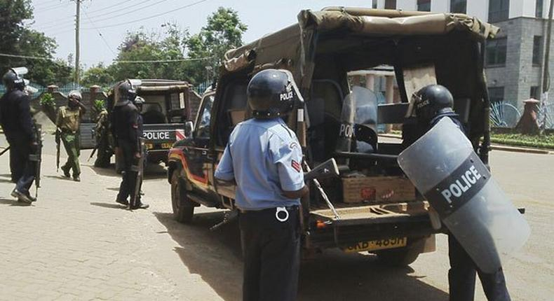 File image of police officers on duty. 7 arrested for impersonating senior government official