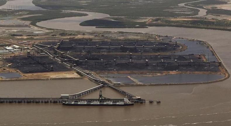 A coal ship waits to be loaded at the port in Gladstone, Queensland, in a file photo. REUTERS/Daniel Munoz
