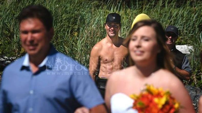 Prime Minister photobomb's beach wedding ceremony