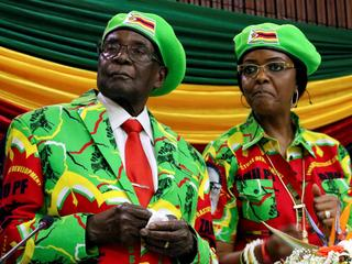 FILE PHOTO: Zimbabwean President Robert Mugabe and his wife Grace attend a meeting of his ruling ZAN