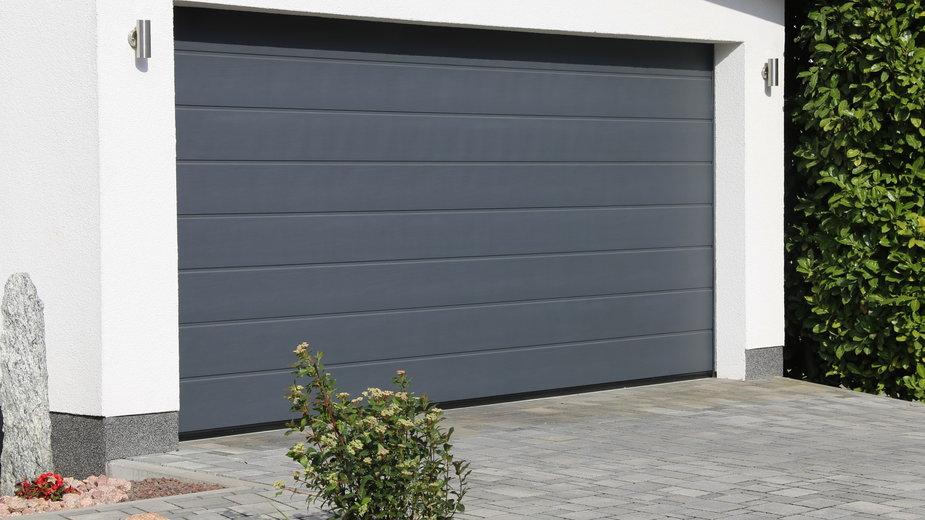 Czy można bez zezwolenia dobudować garaż do istniejącego domu?