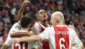 Sebastien Haller (centre) celebrates scoring in Ajax's rout of an out-of-sorts Borussia Dortmund Creator: François WALSCHAERTS