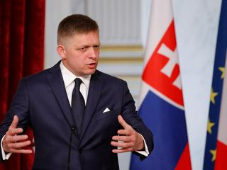 Slovakian Prime Minister Robert Fico gestures as he attends a joint news conference with the French President at the Elysee Palace in Paris