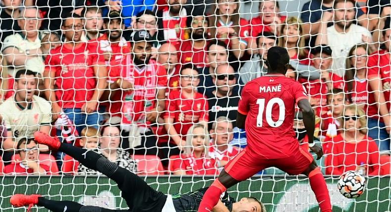 Senegalese Sadio Mane (R) scores his 100th goal for Liverpool in a 3-0 victory over Crystal Palace at Anfield Creator: Paul ELLIS