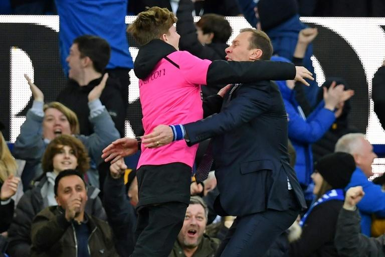 Duncan Ferguson celebrated Everton's third goal with a ball boy