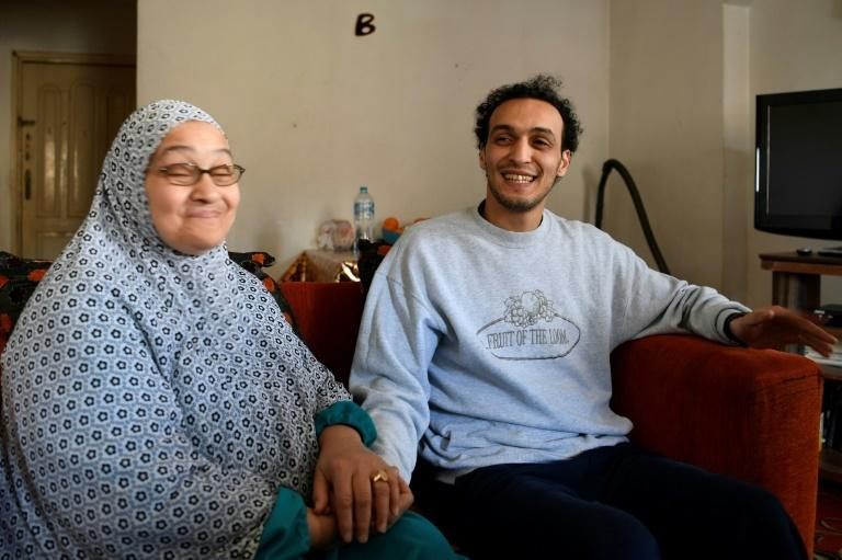 Egyptian photojournalist Mahmoud Abu zeid, widely known as Shawkan, sits with his mother at his home in Cairo following his release