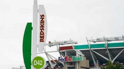 FedEx reportedly threatens to remove signage from the Washington Redskins' home stadium unless the team changes its name (FDX)