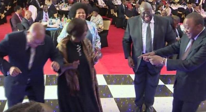 File image of President Uhuru Kenyatta dancing with other dignitaries