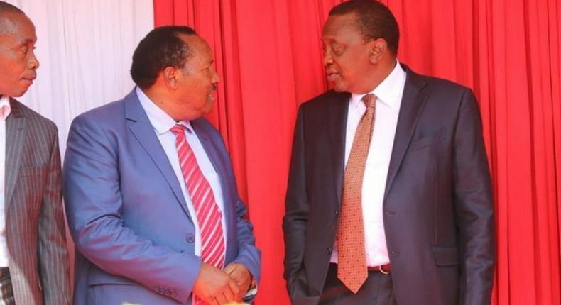 File image of President Uhuru Kenyatta and Ferdinand Waititu at a past event
