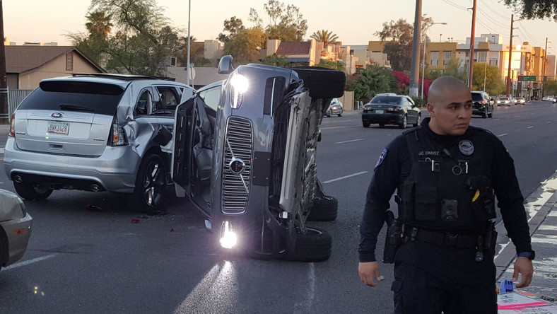 A photo posted on Fresco News' Twitter feed showed a self-driving Uber Volvo SUV on its side.