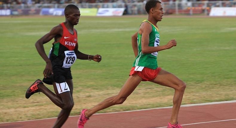 Kenyan Gilbert Kwemoi (Left) and Ethiopian Bekele Ayele Demoz run during the 12th African Juniors Athletics Championships in Addis Ababa, Ethiopia, on March 6, 2015. (Photo by Orhan Karsli/Anadolu Agency/Getty Images)