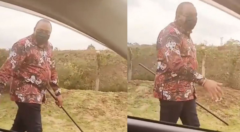 Kenyan's Prez Uhuru Kenyatta walks alone in town as man threatens to shoot him (video)