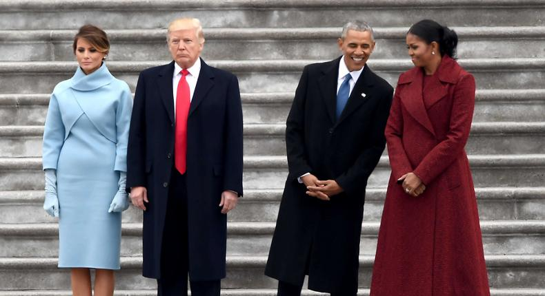 Melania and Donald Trump share a moment with Barack and Michelle Obama at Trump's inauguration ceremony in January 2017.