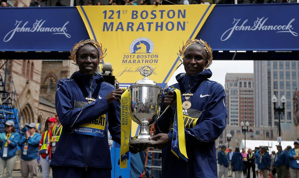 Edna Kiplagat crosses the finish line to win the womens division of the 121st Boston Marathon in Bo