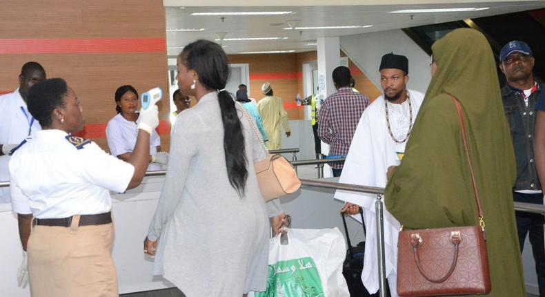 File Photo: Port Health Official screening passengers for Yellow fever at the International Terminal of Nnamdi Azkiwe International Airport in Abuja on Wednesday (30/5/18) /Albert Otu/ICE/NAN