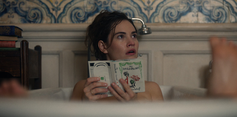 """Lily James as Linda.  The heroine is reading """"Mrs. Dalloway"""" Virginia Woolf"""