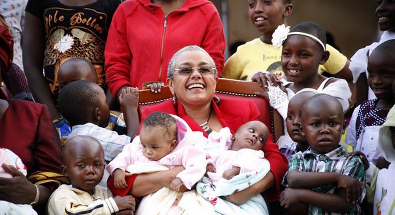 Kenya's First Lady Margaret Kenyatta carring babies.