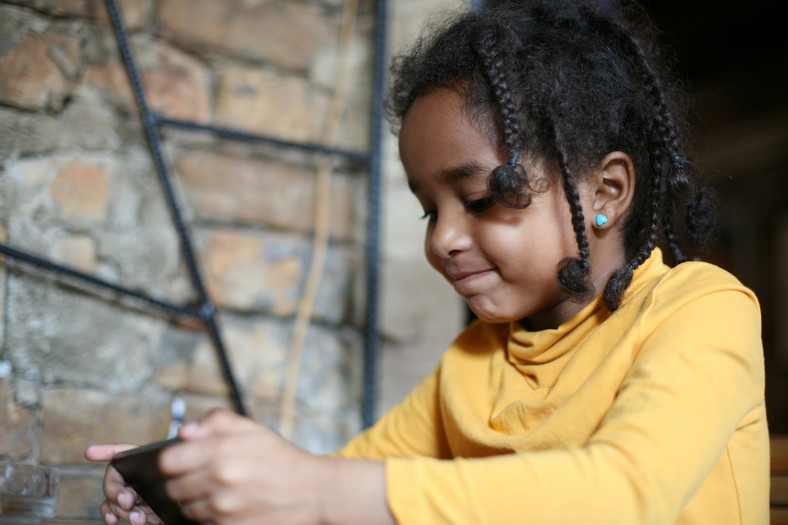 Child on her phone (Courtesy)