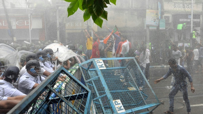 Bharatiya Janata Party activists clash with police during a rally in Kolkata on June 12, 2019