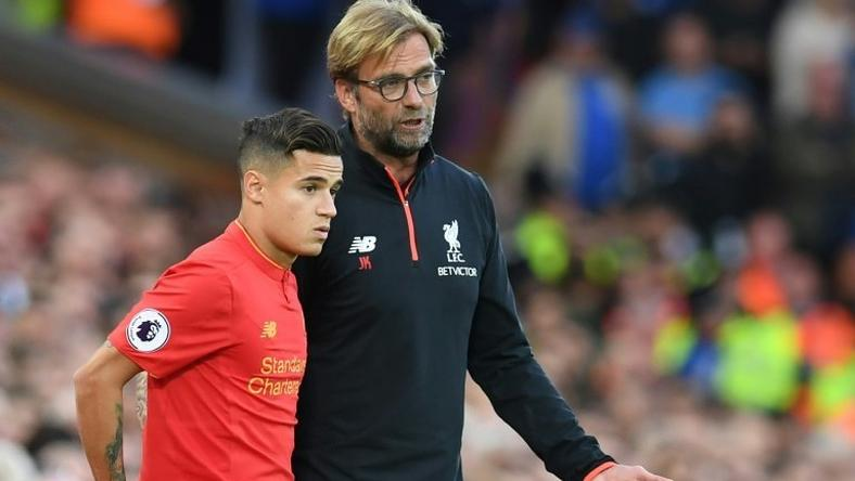Brazil international Philippe Coutinho (L) has been one of Liverpool's key performers this season and he hailed the resilience that coach Jurgen Klopp (R) has instilled in the squad