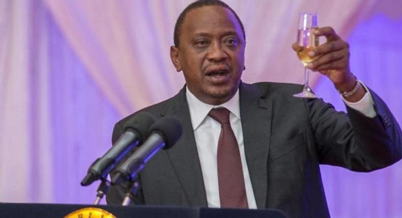 President Uhuru Kenyatta toasting to happy life at a past event.