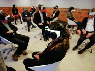 Participants attend the 'Collisions. A Virtual Reality World Premiere' event at the annual meeting o