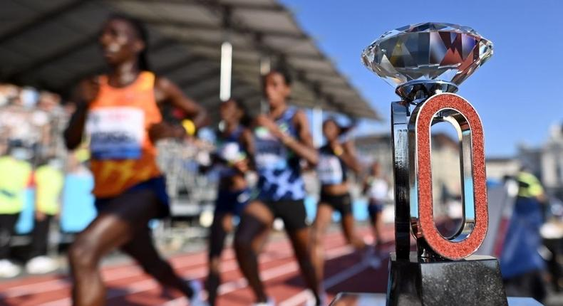 Athletes run by the Diamond League trophy as they compete in the women's 5000m at The Diamond League athletics meeting in Zurich on September 8, 2021 (Photo by Fabrice COFFRINI / AFP) (Photo by FABRICE COFFRINI/AFP via Getty Images)