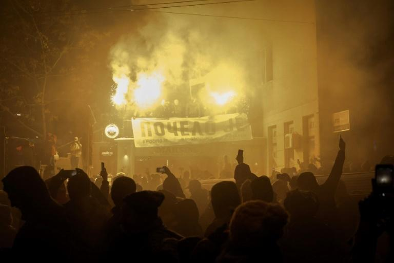 On January 5, some protesters lit torches as thousands joined the latest proest march in Belgrade