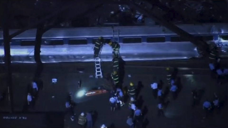 Aerial footage of first responders working at the scene of a train derailment in Philadephia